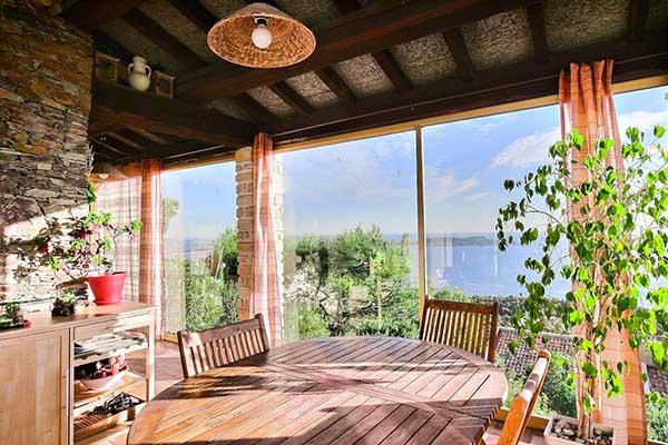 Veranda of the villa with 180° sea view on the Hill la Californie in Carqueiranne